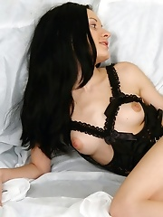 Dark-haired cutie in a bed